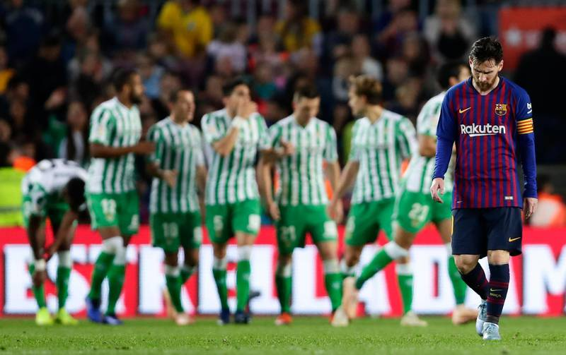 FC Barcelona's Lionel Messi, right, reacts after Betis scored during the Spanish La Liga soccer match between FC Barcelona and Betis at the Camp Nou stadium in Barcelona, Spain, Sunday, Nov. 11, 2018. (AP Photo/Manu Fernandez)