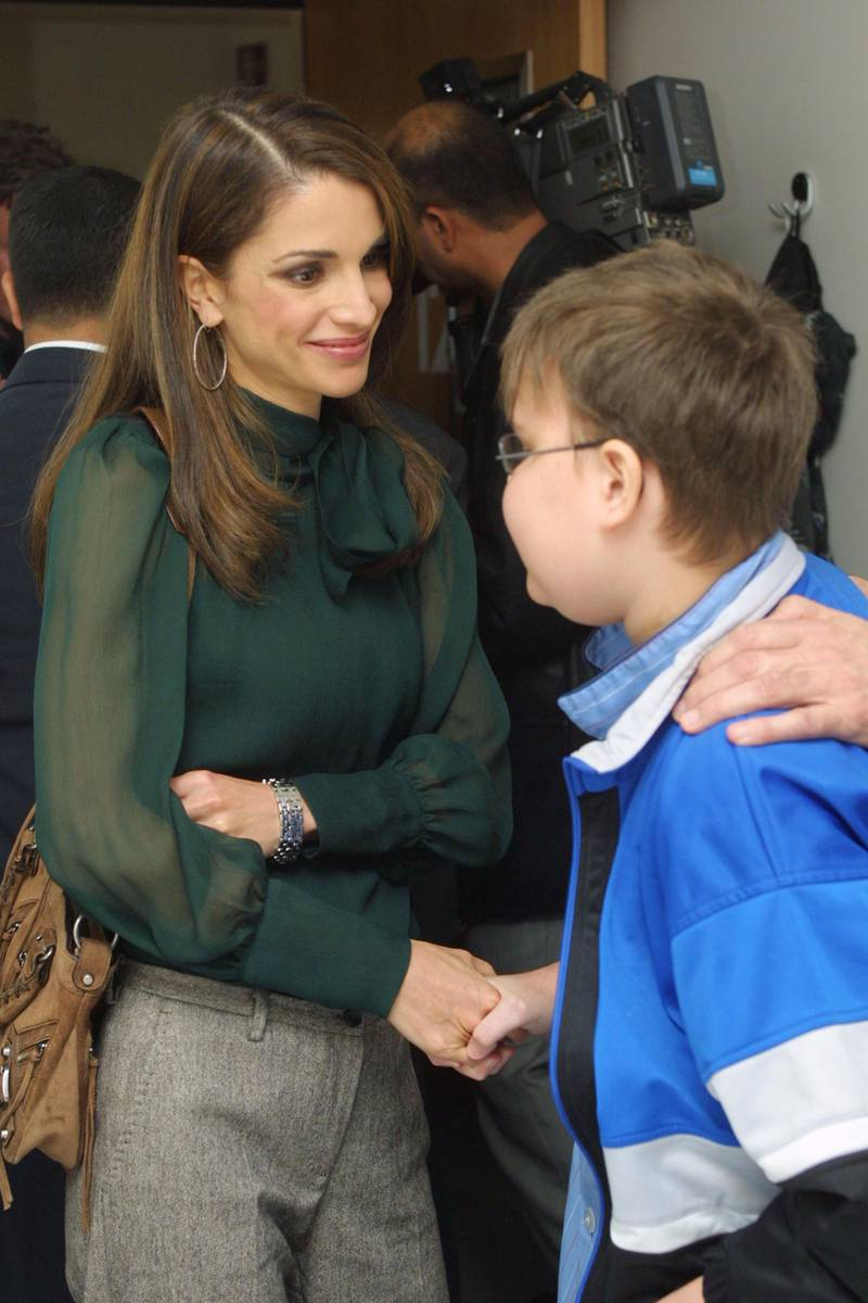 BERLIN - OCTOBER 23:  Jordanian Queen Rania says goodbye to Florian Remmers, 13, who is recovering from a liver transplant at the Children's Clinic of Charite Hospital October 23, 2002 in Berlin, Germany. Queen Rania and her husband King Abdullah are on a four-day visit to Germany.  (Photo by Sean Gallup/Getty Images)