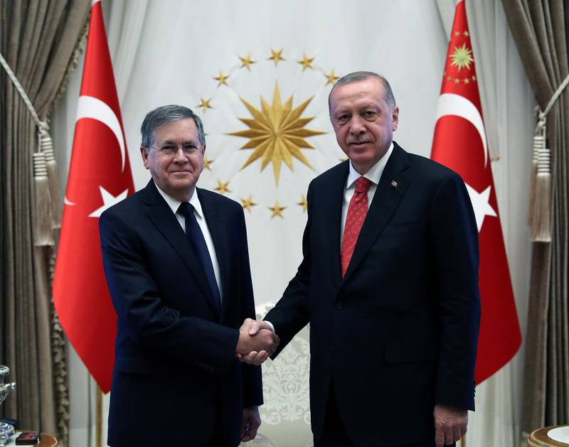 Turkish President Tayyip Erdogan shakes hands with U.S. Ambassador to Turkey David M. Satterfield during a ceremony to receive credentials from newly appointed foreign ambassadors to Turkey at the Presidential Palace in Ankara, Turkey, August 28, 2019. Cem Oksuz/Presidential Press Office/Handout via REUTERS ATTENTION EDITORS - THIS PICTURE WAS PROVIDED BY A THIRD PARTY. NO RESALES. NO ARCHIVE