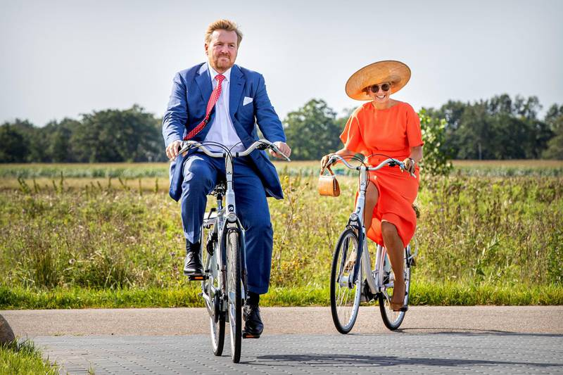 OOSTSTELLINGSWERF, NETHERLANDS - SEPTEMBER 17: King Willem-Alexander of The Netherlands and Queen Maxima of The Netherlands ride on bicycles as they visit ECOstyle, Biosintrum and EcoMinutypark during their visit to the region of South East Friesland on September 17, 2020 in Ooststellingswerf, Netherlands. The theme of the visit is sustainable entrepreneurship and the cooperation with the education sector.  (Photo by Patrick van Katwijk/Getty Images)