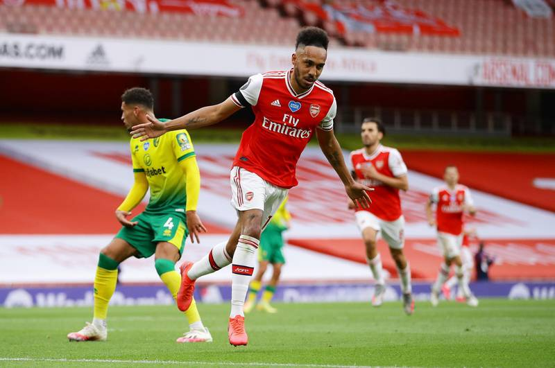 """Soccer Football - Premier League - Arsenal v Norwich City - Emirates Stadium, London, Britain - July 1, 2020 Arsenal's Pierre-Emerick Aubameyang celebrates scoring their third goal, as play resumes behind closed doors following the outbreak of the coronavirus disease (COVID-19) Richard Heathcote/Pool via REUTERS  EDITORIAL USE ONLY. No use with unauthorized audio, video, data, fixture lists, club/league logos or """"live"""" services. Online in-match use limited to 75 images, no video emulation. No use in betting, games or single club/league/player publications.  Please contact your account representative for further details."""