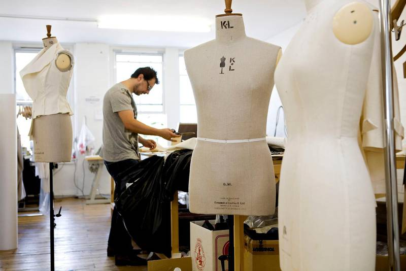 London, August 14 2008. A cutter at work at fashion label Qasimi, at the company's East London studio. Qasimi is run by Elliott Frieze and Khalid Alqasimi. (Matt Crossick)
