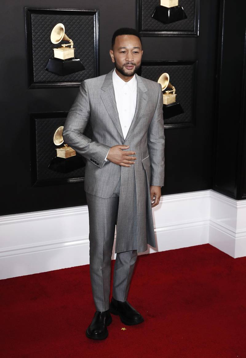 epa08168743 John Legend arrives for the 62nd Annual Grammy Awards ceremony at the Staples Center in Los Angeles, California, USA, 26 January 2020.  EPA-EFE/ETIENNE LAURENT