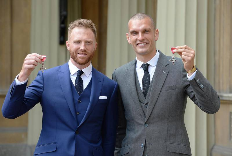 LONDON, UNITED KINGDOM - MARCH 16:  William Satch and Mohamed Sbihi (R) hold their MBE Medals after receiving them from the Prince of Wales during an investiture ceremony at Buckingham Palace on March 16, 2017 in London, England. (Photo by  John Stillwell - WPA Pool/Getty Images)
