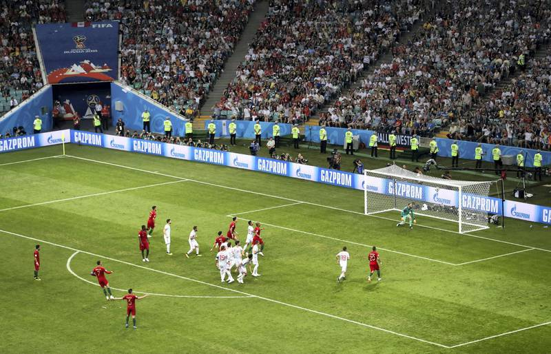 SOCHI, RUSSIA - JUNE 15:  Cristiano Ronaldo of Portugal scores a free-kick for his team's third goal during the 2018 FIFA World Cup Russia group B match between Portugal and Spain at Fisht Stadium on June 15, 2018 in Sochi, Russia.  (Photo by Michael Steele/Getty Images)