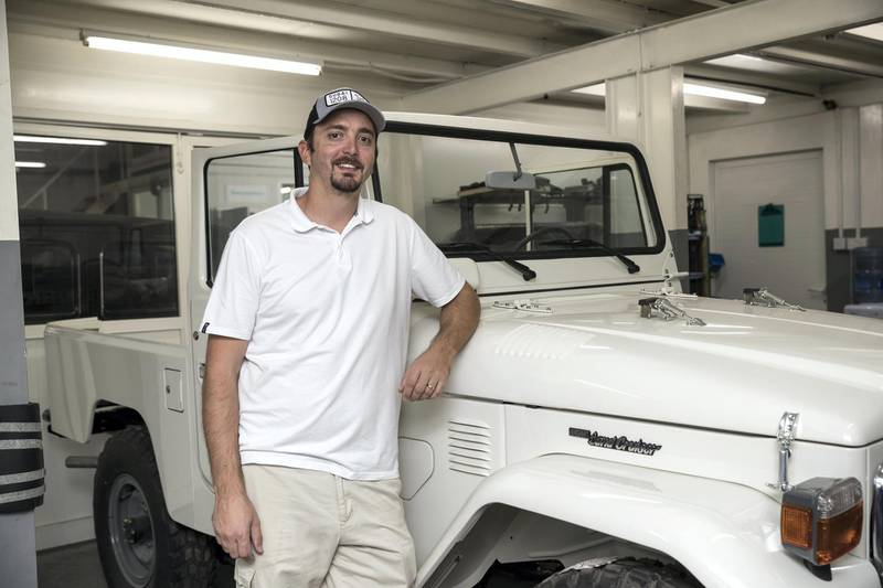 DUBAI, UNITED ARAB EMIRATES. 04 FEBRUARY 2018. Workshop visit to Dubai company Sebsports that restores vintage Land Rovers And Toyota Land Cruisers to concours standard at their Al Quoz workshop. Owner Seb Husseini shows off a current projetct. A Toyota Landcruiser, 1983 fj43 Soft Top that use to belong to the Ruler of Al Ain. (Photo: Antonie Robertson/The National) Journalist: Adam Workman. Section: Motoring.