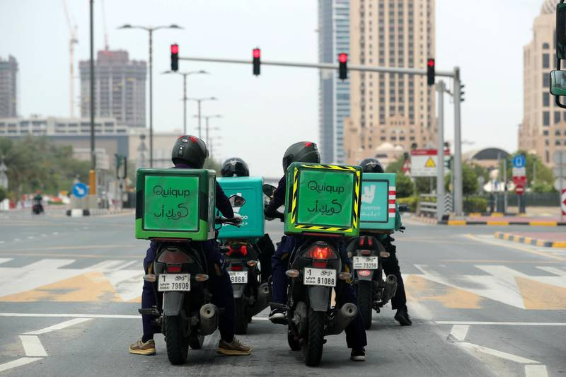 Dubai, United Arab Emirates - Reporter: N/A: Coronavirus. Delivery drivers wait at a red light during the 24hr lockdown due to Covid-19. Tuesday, April 14th, 2020. Dubai. Chris Whiteoak / The National