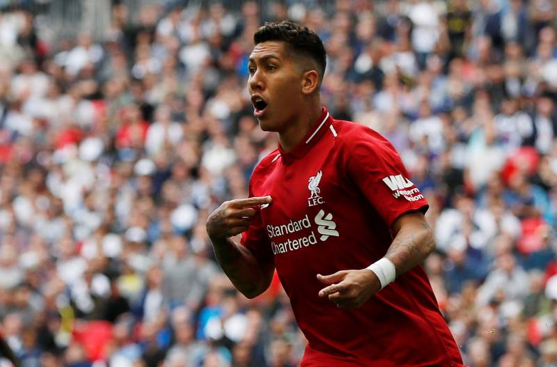 """Soccer Football - Premier League - Tottenham Hotspur v Liverpool - Wembley Stadium, London, Britain - September 15, 2018  Liverpool's Roberto Firmino celebrates a goal which is later disallowed for offside  Action Images via Reuters/Paul Childs  EDITORIAL USE ONLY. No use with unauthorized audio, video, data, fixture lists, club/league logos or """"live"""" services. Online in-match use limited to 75 images, no video emulation. No use in betting, games or single club/league/player publications.  Please contact your account representative for further details."""