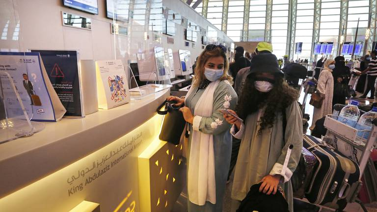 An image that illustrates this article Saudi student who spent $2,000 on Covid tests cheers UK travel rule change