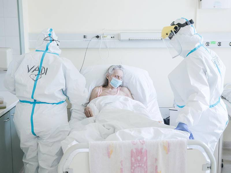 The medical staff takes care of a Covid-19 positive patient at the Uzsoki Hospital, Hungary. The ongoing COVID-19 pandemic spread to Hungary on 4 March 2020, when the first cases in the country were announced. The first coronavirus-related death was announced on 15 March on the government's official website.On 11 March, the Hungarian government declared a state of emergency.