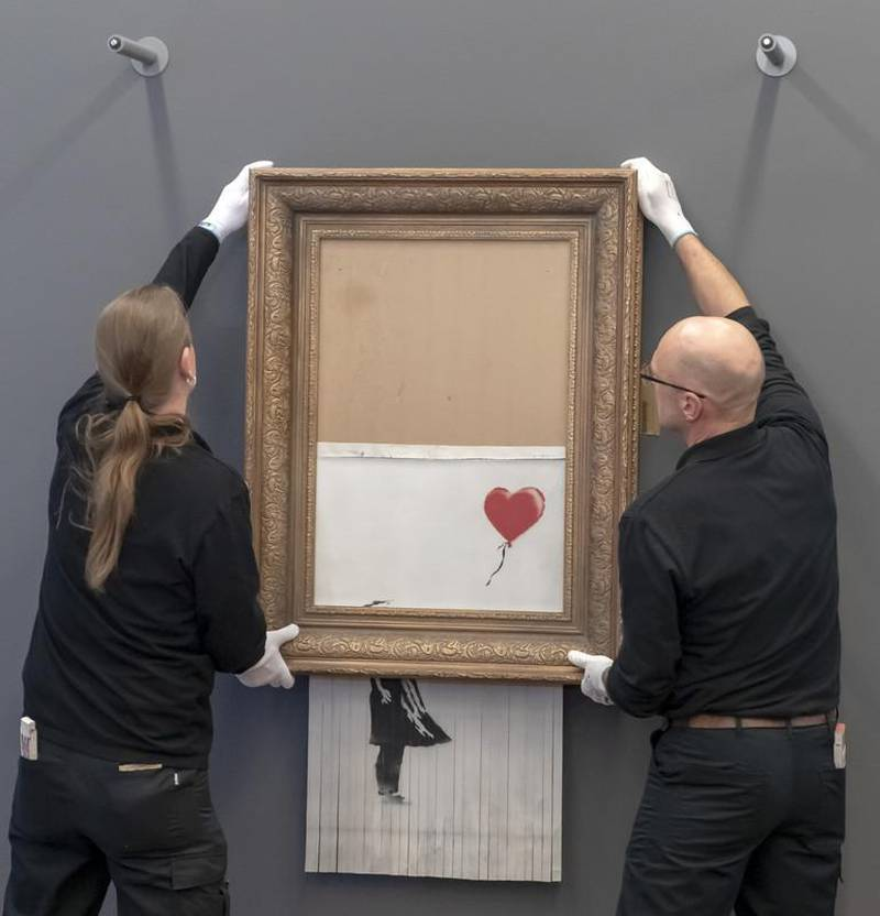 epa07342914 Museum employees hang Banksy's 'Love is in the Bin' artwork at the Frieder Burda Museum in Baden-Baden., Germany, 04 February 2019. The Frieder Burda Museum will be showing from 05 February 2019 to 03 March 2019 to the public for the first time the Banksy work 'Love is in the Bin', acquired by a European collector and auctioned off at Sotheby's in London.  EPA-EFE/RONALD WITTEK