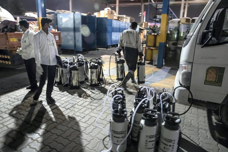SHARJAH, UNITED ARAB EMIRATES. 26 MARCH 2020. Sharjah Municipal staff prepare spray canisters at the main Enviroment Services Department of the Sharjah Municipality to disinfect the streets of Sharjah after the mandatory 8pm curfew. (Photo: Antonie Robertson/The National) Journalist: None. Section: National.