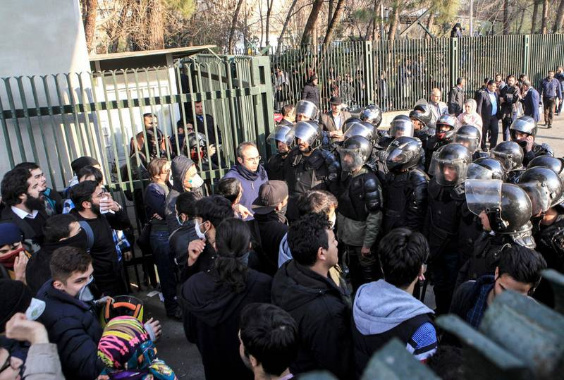 FILE- In this Dec. 30, 2017 file photo taken by an individual not employed by the Associated Press and obtained by the AP outside Iran, anti-riot Iranian police prevent university students to join other protesters over Iran weak economy, in Tehran, Iran. New unrest in Iran over the past 10 days appears to be waning, but anger over the economy persists. The protests in dozens of towns and cities also showed that a sector of the public was willing to openly call for the removal of Iran's system of rule by clerics -- frustrated not just by the economy but also by concern over Iran's foreign wars and general direction. (AP Photo, File)