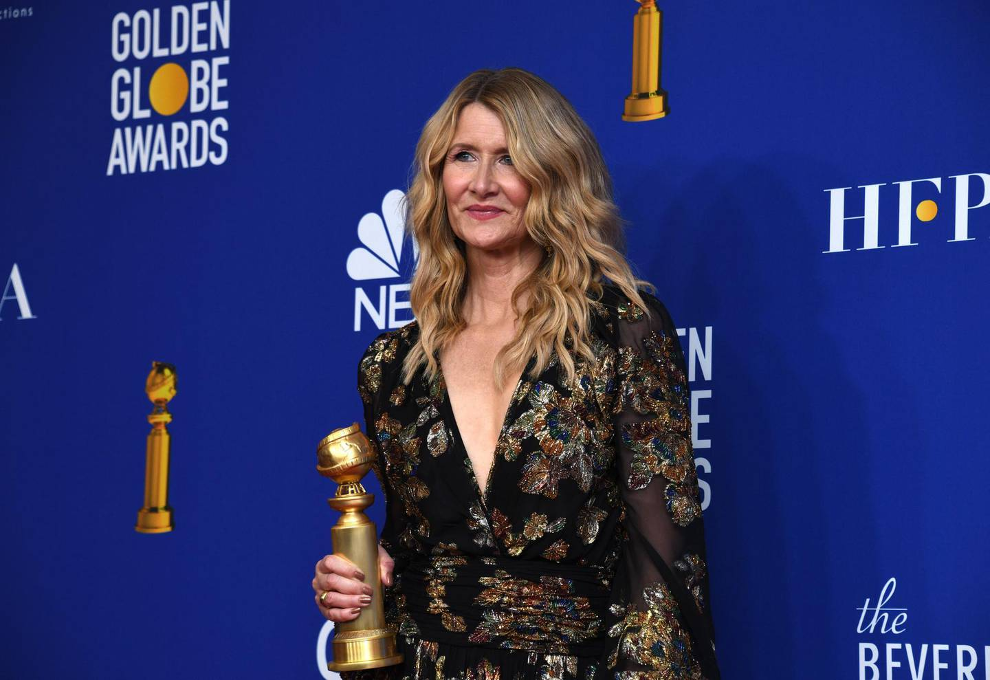 epa08106171 Laura Dern poses with the award for Best Performance By An Actress In a Supporting Role In Any Motion Picture in the press room during the 77th annual Golden Globe Awards ceremony at the Beverly Hilton Hotel, in Beverly Hills, California, USA, 05 January 2020.  EPA/CHRISTIAN MONTERROSA