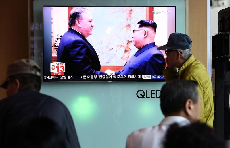 SEOUL, SOUTH KOREA - MAY 09:  South Koreans watch on a screen reporting the U.S. Secretary of State Mike Pompeo visit to North Korea at the Seoul Railway Station on May 9, 2018 in Seoul, South Korea. The U.S. President Donald Trump announced today that the U.S. Secretary of State Mike Pompeo is on his way to North Korea to finalise plans for the summit with his North Korean counterpart Kim Jong-Un. It is Pompeo's second trip to Pyongyang after a meeting with Kim last month as CIA director.  (Photo by Chung Sung-Jun/Getty Images)