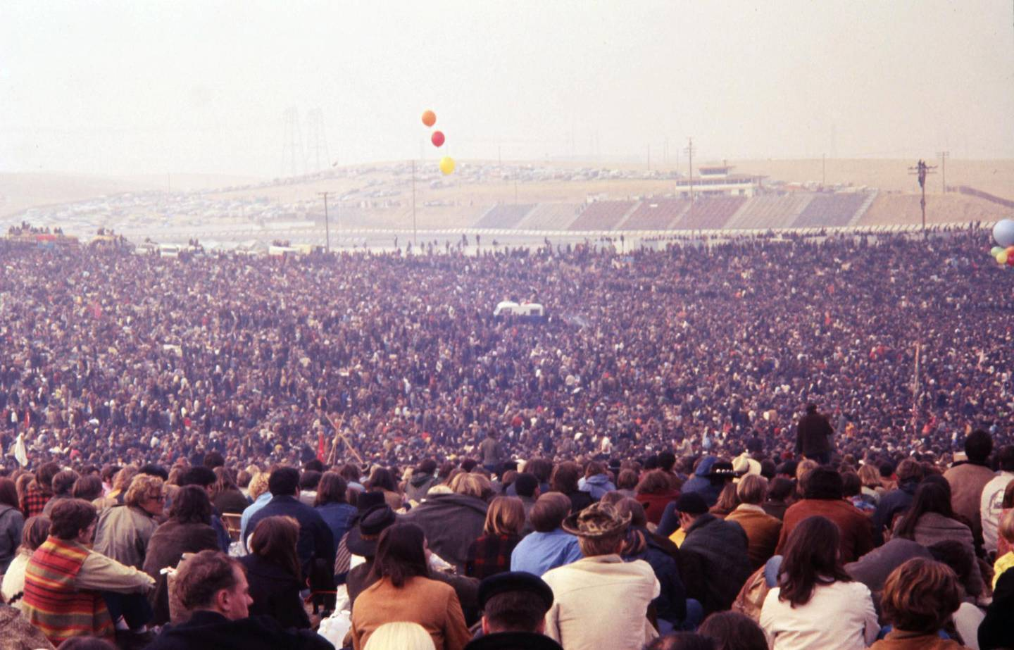 The racetrack's bleachers could not accommodate the rumoured number of 300,000 that the concert attracted. (Photo by William L. Rukeyser/Getty Images)
