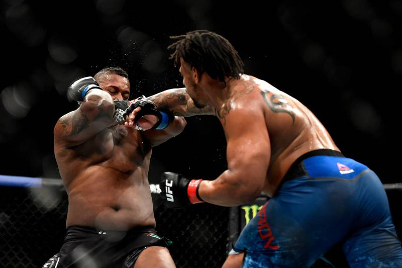 JACKSONVILLE, FLORIDA - MAY 09: Greg Hardy (R) of the United States punches Yorgan De Castro (L) of Cape Verde in their Heavyweight fight during UFC 249 at VyStar Veterans Memorial Arena on May 09, 2020 in Jacksonville, Florida.   Douglas P. DeFelice/Getty Images/AFP