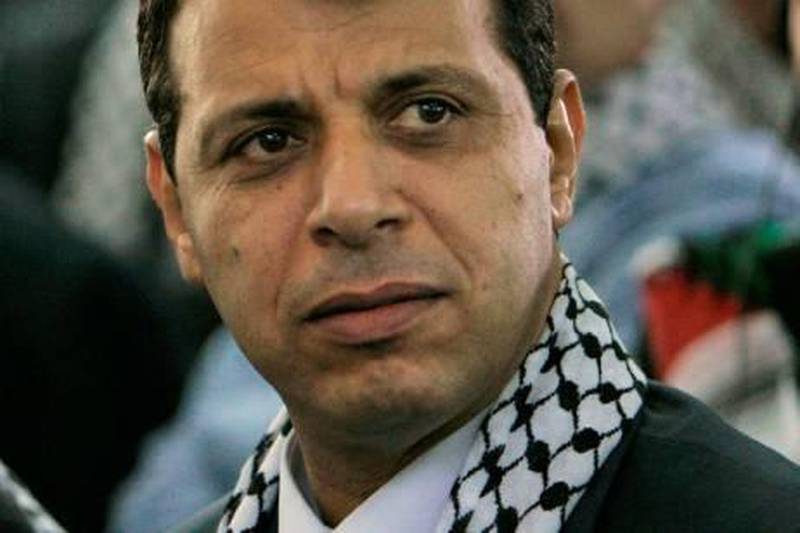 Palestinian Fatah leader Mohammed Dahlan listens to a speech during the Fatah conference in the West Bank town of Bethlehem, Tuesday, Aug. 4, 2009. The Palestinians' Fatah movement came together Tuesday for its first convention in 20 years, trying to rise from division and defeat with a pragmatic political program and new leaders, in what its supporters hope will be the final push toward Palestinian statehood. (AP Photo/Tara Todras-Whitehill)  *** Local Caption ***  JRL124_MIDEAST_ISRAEL_PALESTINIANS_FATAH_CONFERENCE.jpg