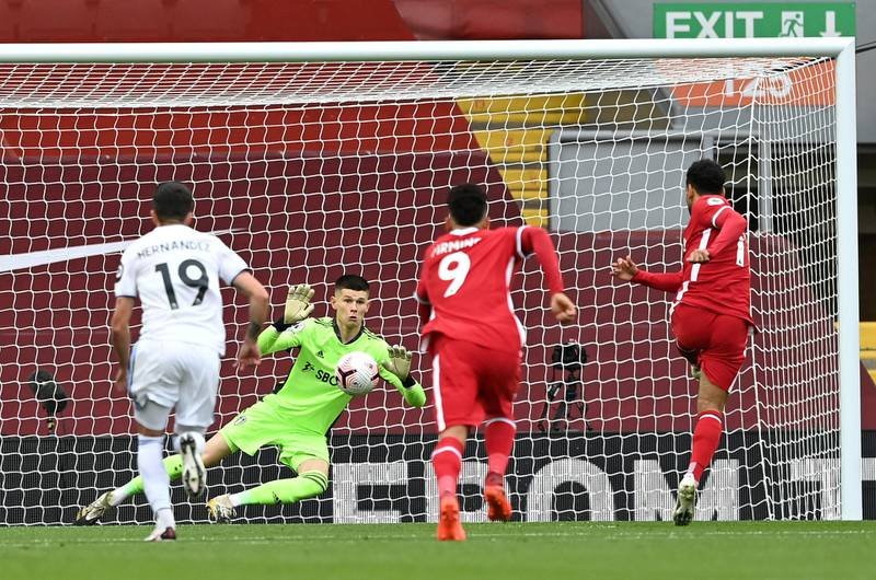 LIVERPOOL, ENGLAND - SEPTEMBER 12: Mohamed Salah of Liverpool scores his team's first goal past Illan Meslier of Leeds United during the Premier League match between Liverpool and Leeds United at Anfield on September 12, 2020 in Liverpool, England. (Photo by Shaun Botterill/Getty Images)