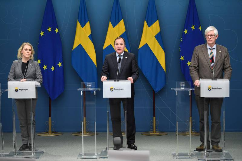 (L-R) Sweden's Minister of Social Affairs Lena Hallengren, Prime Minister Stefan Lofven and the Swedish Public Health Agency's Secretary General Johan Carlsson attend a press conference after the parliament adopted a temporary pandemic law on January  8, 2021 in Stockholm. Sweden's parliament passed a pandemic law giving the government new powers to curb the spread of Covid-19 in a country that has controversially relied on mostly non-coercive measures up to now.  - Sweden OUT  / AFP / TT NEWS AGENCY