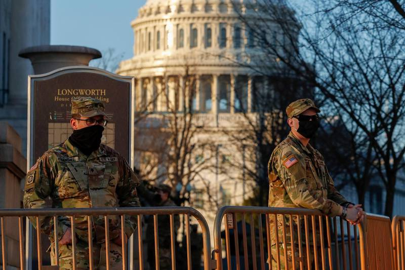 epa08933854 National Guard soldiers stand post near the US Capitol in Washington, DC, USA, 12 January 2021. The House will vote tonight to invoke the 25th amendment forcing Vice President Mike Pence to meet with members of the cabinet about removing US President Donald J. Trump from office for incitement of insurrection following the attack on the US Capitol on 06 January as lawmakers worked to certify Joe Biden as the next President of the United States.  EPA/SHAWN THEW