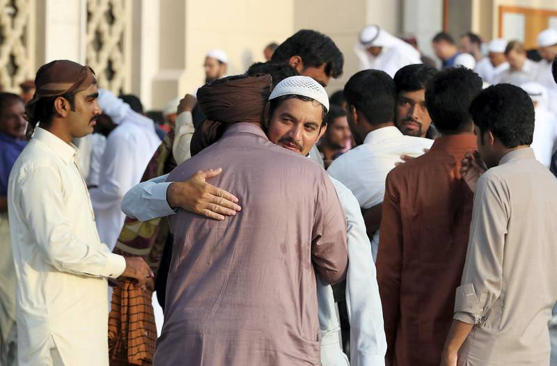 DUBAI, UNITED ARAB EMIRATES, August 21 – 2018 :- People greeting each other after the Eid Al Adha prayers at the Jumeirah Mosque in Dubai. ( Pawan Singh / The National )  For News. Story by Nawal