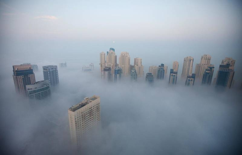Dubai, January 28, 2013 -  Morning fog descends over Dubai Marina in Dubai, January 28, 2013. (Photo by: Sarah Dea/The National)