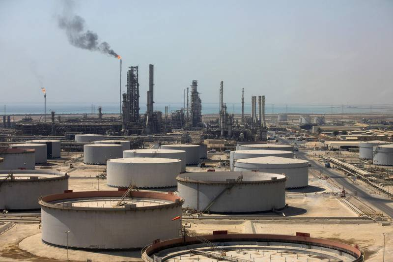 Crude oil storage tanks stand at the oil refinery operated by Saudi Aramco in Ras Tanura, Saudi Arabia, on Monday, Oct. 1, 2018. Saudi Aramcoaims to become a global refiner and chemical maker, seeking to profit from parts of the oil industry where demand is growing the fastest while also underpinning the kingdom's economic diversification. Photographer: Simon Dawson/Bloomberg