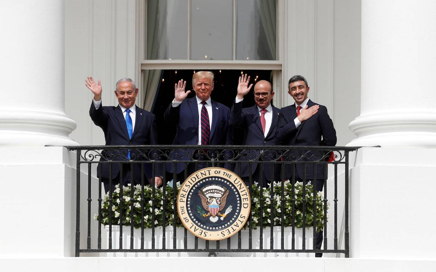 FILE PHOTO: Israel's Prime Minister Benjamin Netanyahu, U.S. President Donald Trump, Bahrain's Foreign Minister Abdullatif Al Zayani and United Arab Emirates (UAE) Foreign Minister Abdullah bin Zayed wave from the White House balcony after a signing ceremony for the Abraham Accords, normalizing relations between Israel and some of its Middle East neighbors, in a strategic realignment of Middle Eastern countries against Iran, on the South Lawn of the White House in Washington, U.S., September 15, 2020. REUTERS/Tom Brenner/File Photo