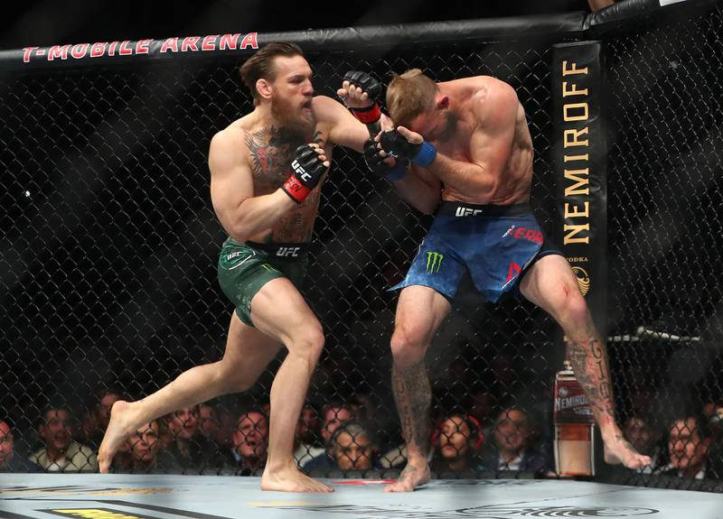 January 18, 2020; Las Vegas, Nevada, USA; Conor McGregor moves in for a hit against Donald Cerrone during UFC 246 at T-Mobile Arena. Mandatory Credit: Mark J. Rebilas-USA TODAY Sports