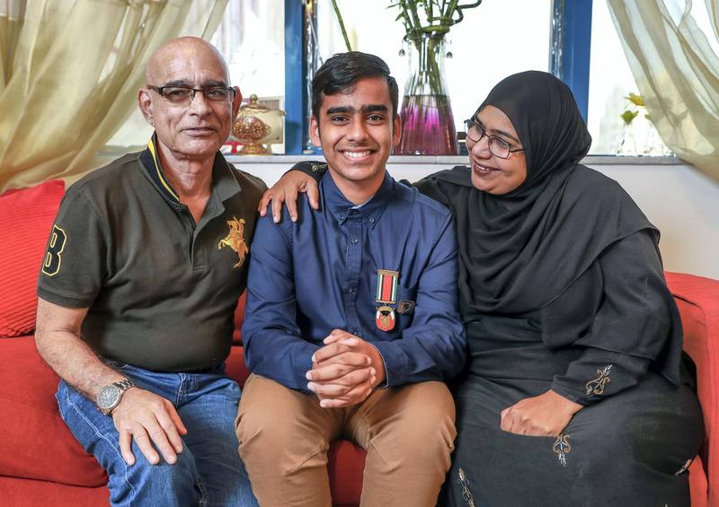 Abu Dhabi, U.A.E., November 5, 2018.  Abu Dhabi student nominated for International Children's peace prize, Abdul Muqeet with his proud parents, Abdul Sr. and Andaleeb. Victor Besa / The NationalSection:  NAReporter:  Patrick Ryan
