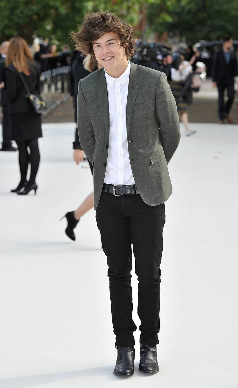 LONDON, ENGLAND - SEPTEMBER 17:  Harry Styles arrives at the Burberry Spring Summer 2013 Womenswear Show at Kensington Gardens on September 17, 2012 in London, England.  (Photo by Gareth Cattermole/Getty Images for Burberry)
