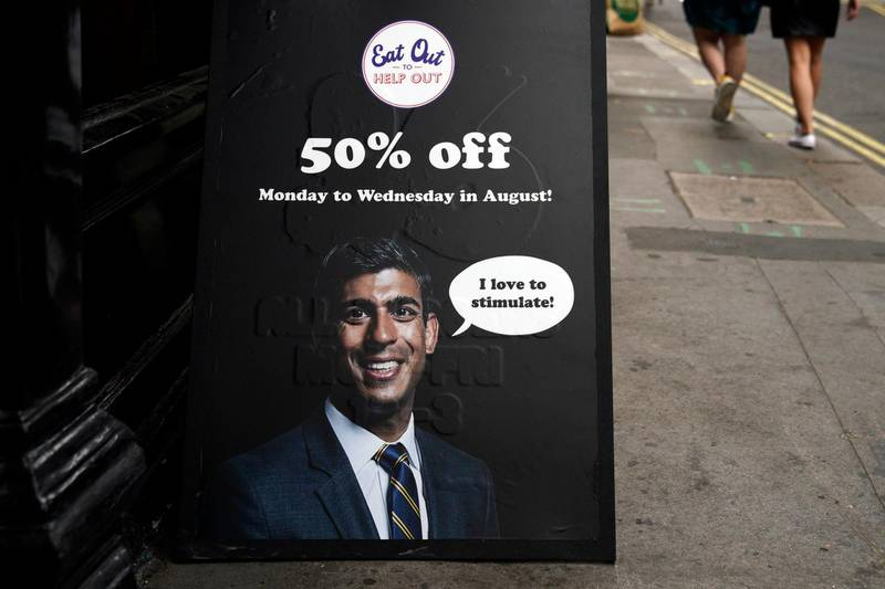epa08601388 A sign advertising 'Eat Out to Help Out' scheme by Chancellor of the Exchequer Rishi Sunak near Oxford Street, Central London, Britain, 13 August 2020. According to news reports, the UK is now officially in recession. Britain is set to experience its worst recession on record after data showed the Coronavirus sent the UK economy plunging by over twenty percent for the second quarter of 2020.  EPA/WILL OLIVER