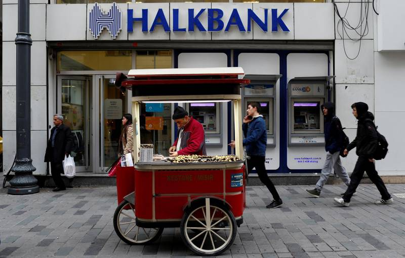 FILE PHOTO: A street vendor sells roasted chestnuts in front of a branch of Halkbank in central Istanbul, Turkey, January 10, 2018. REUTERS/Murad Sezer/File Photo