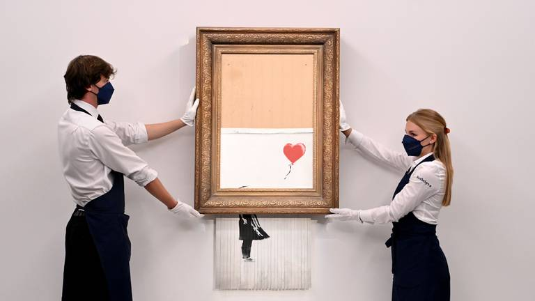 An image that illustrates this article Half-shredded Banksy artwork sells for $25m