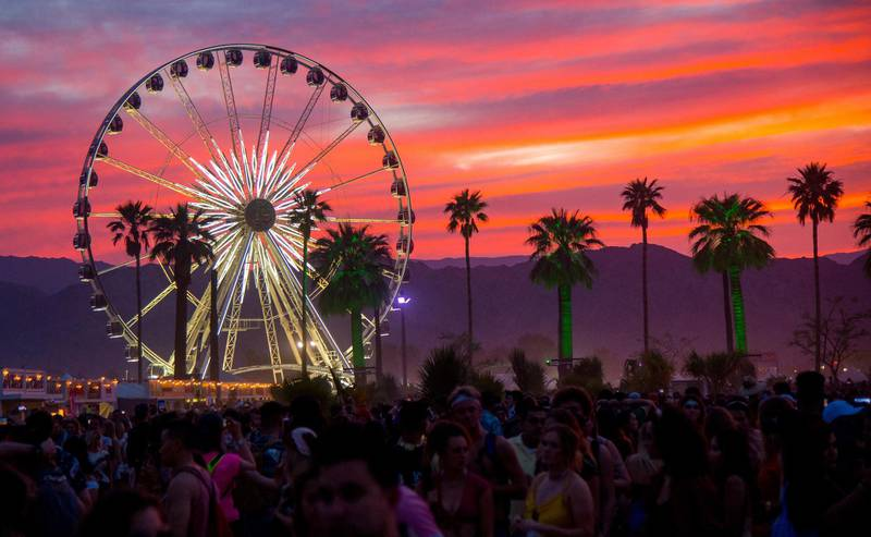 FILE - In this April 21, 2018 file photo, the sun sets over the Coachella Music & Arts Festival in Indio, Calif. The Coachella and Stagecoach music festivals have been canceled for 2020 due to coronavirus concerns. Riverside County's public health officer signed an order Wednesday, June 10, 2020, to cancel the popular festivals this year outside Palm Springs, Calif. (Photo by Amy Harris/Invision/AP, File)