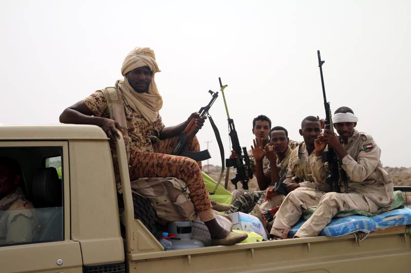 epa06803022 Sudanese forces fighting alongside the Saudi-led coalition in Yemen gather near the outskirts of the western port city of Hodeidah, Yemen, 12 June 2018. According to reports, the Saudi-led military coalition and Yemeni government forces continue to send reinforcements toward the port city of Hodeidah, preparing to launch an assault on the Houthis-controlled main port of Yemen.  EPA/NAJEEB ALMAHBOOBI