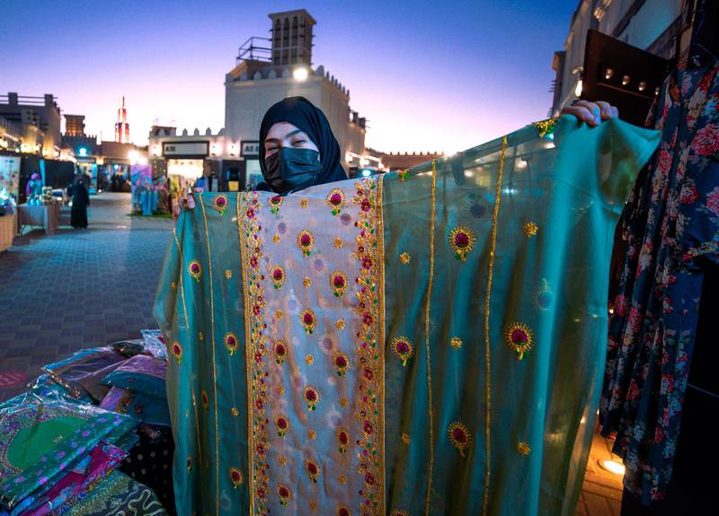 Abu Dhabi, United Arab Emirates, January 10, 2021.  Mariam Al Shehi displays a hand stiched cloth at the Arabic market at Sheikh Zayed Festival.Victor Besa/The NationalSection:  NAReporter:  Saeed Saeed