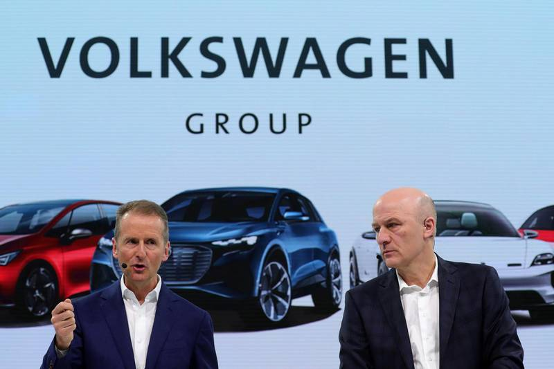 Herbert Diess, chief executive officer of Volkswagen AG (VW), left, speaks beside Frank Witter, chief financial officer of Volkswagen AG (VW), during the automaker's annual news conference in Wolfsburg, Germany, on Tuesday, March 12, 2019.  Volkswagen's profitability for the main VW, Audi and Porsche brands fell last year amid strains for the transition to electric cars and the German carmaker's push for a deeper overhaul. Photographer: Krisztian Bocsi/Bloomberg