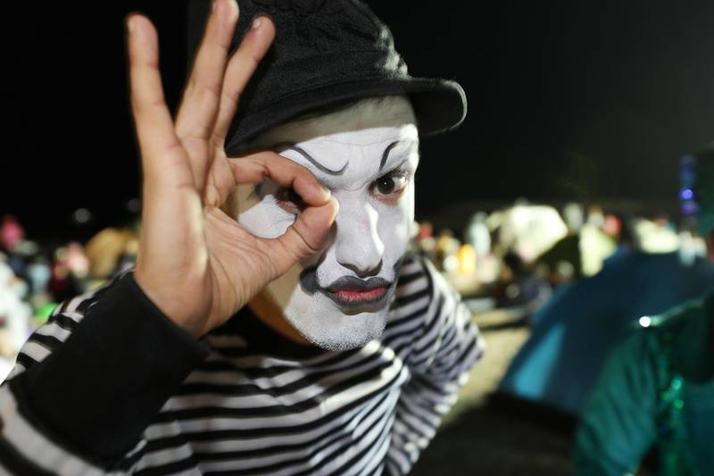 Ras Al Khaimah, United Arab Emirates - Reporter: N/A: Street entertainers at the beach as Ras Al Khaimah puts on a record-breaking fireworks display on New Year's Eve. Tuesday, December 31st, 2019. Al Hamra, Ras Al Khaimah. Chris Whiteoak / The National