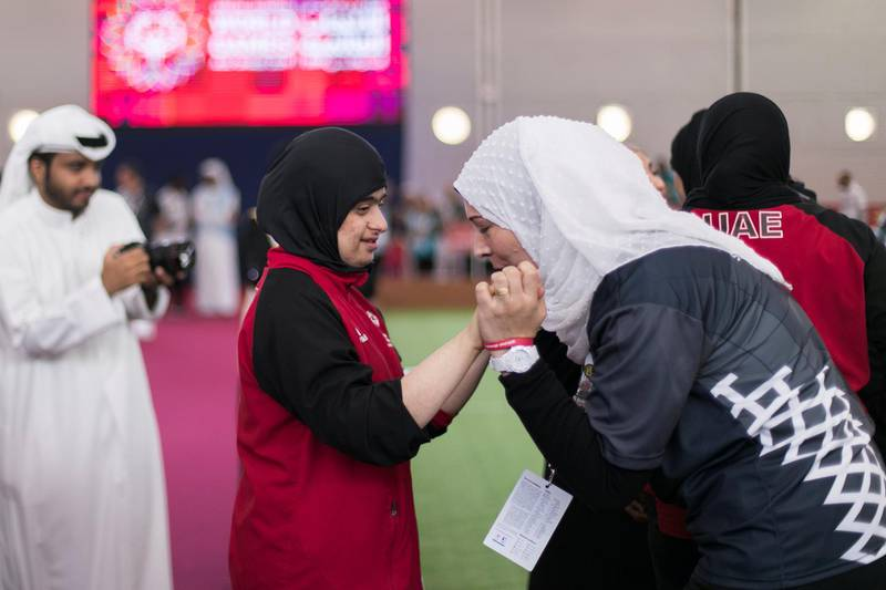 ABU DHABI, UNITED ARAB EMIRATES - March 20 2019.  An woman kisses UAE's bocce athlete Mariam Al Mulla hand, celebrating her gold medal win against Hong Kong at the Special Olympics World Games in ADNEC.   (Photo by Reem Mohammed/The National)  Reporter:  Section:  NA