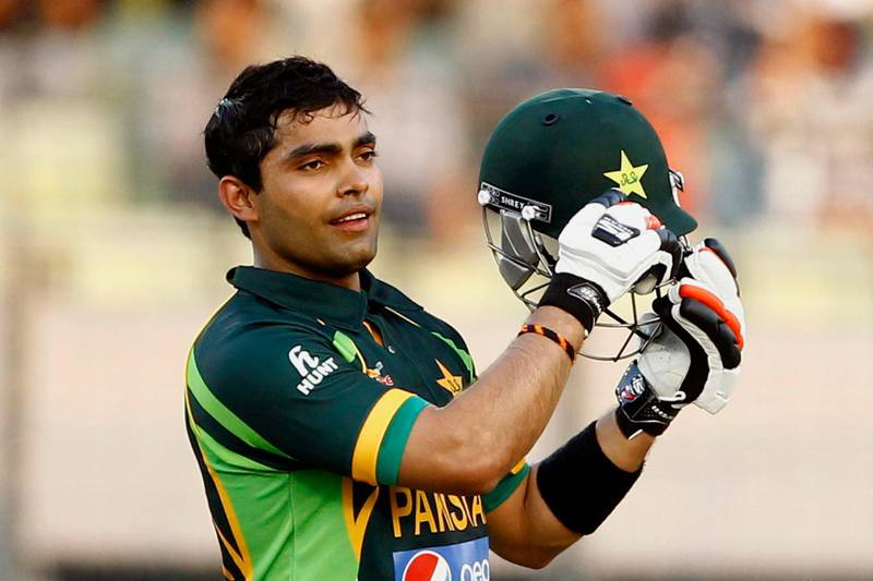 FILE - In this March 8, 2014, file photo, Pakistan's Umar Akmal celebrates against Sri Lanka during their Asia Cup final cricket match in Dhaka, Bangladesh. The Pakistan Cricket Board has suspended batsman Umar Akmal under its anti-corruption code hours before the start of its domestic Twenty20 tournament in Karachi. (AP Photo/A.M. Ahad, File)
