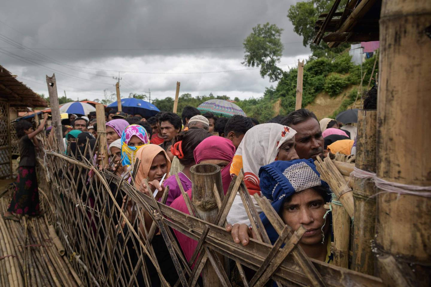 TOPSHOT - Rohingya refugees queue at an aid relief distribution centre at the Balukhali refugee camp near Cox's Bazar on August 12, 2018. (Photo by Ed JONES / AFP)