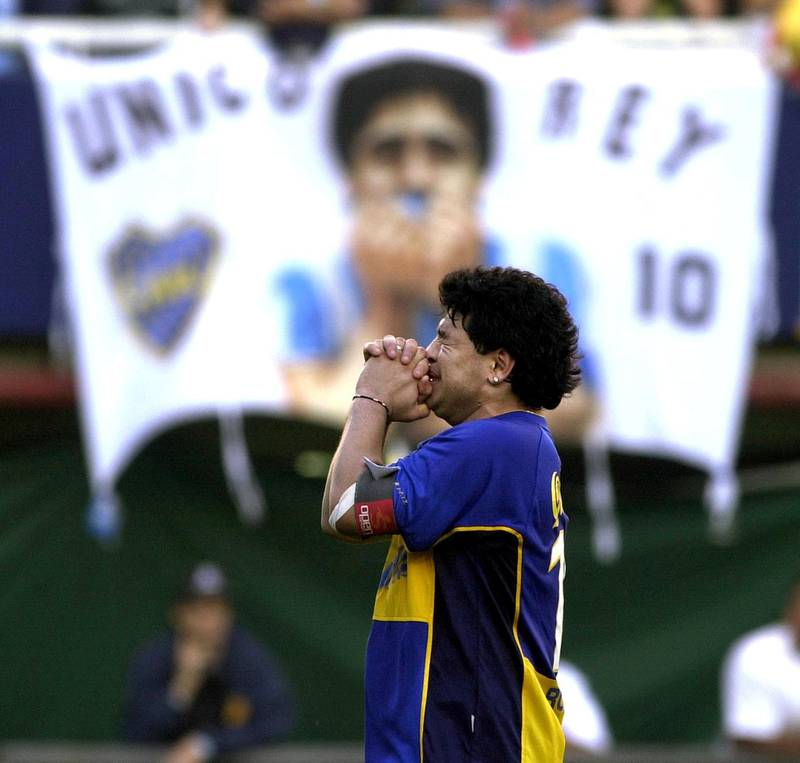 """Former Argentine soccer star Diego Maradona is overcome with emotion during an event in his honor at the """"La Bombonera"""" stadium of Boca Juniors soccer team 10 November 2001 in Buenos Aires.    AFP PHOTO/Ali BURAFI (Photo by ALI BURAFI / AFP)"""