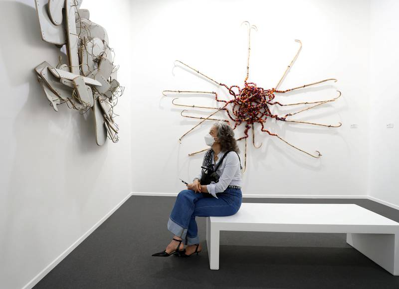 Dubai, United Arab Emirates - Reporter: Alexandra Chaves. Arts and Lifestyle. A visitor looks at a piece by Mohamed Arejdal called Spiritualités vierges. Art Dubai 2021 opens at the DIFC. Tuesday, March 30th, 2021. Dubai. Chris Whiteoak / The National
