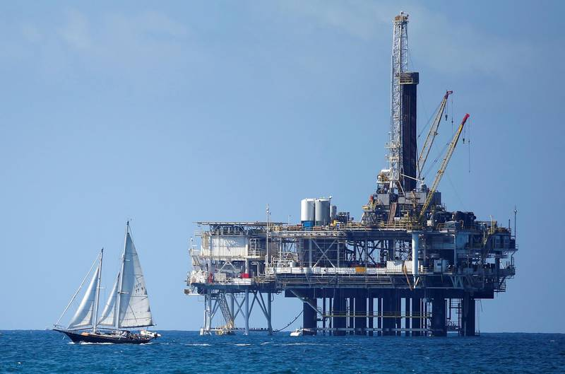 FILE PHOTO: An offshore oil platform is seen in Huntington Beach, California September 28, 2014. Brent oil prices fell more than $2 a barrel to less than $88 on Monday, its lowest since 2010, after key Middle East producers signalled they would keep output high even if that meant lower prices. Brent oil prices have tanked by nearly 25 percent since June as ample supply coincided with weak demand, raising the possibility that the Organization of the Petroleum Exporting countries could cut output.  Picture taken September 28, 2014. REUTERS/Lucy Nicholson/File Photo