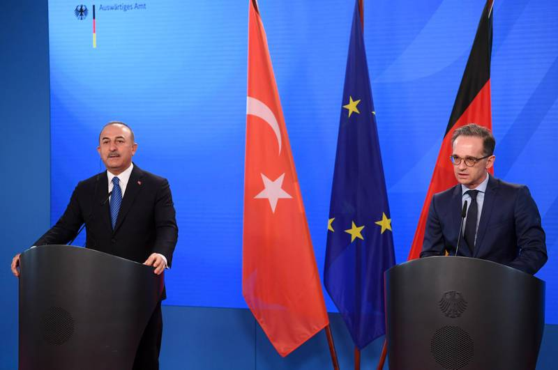 epa09180513 German Foreign Minister Heiko Maas (R) and Turkish Foreign Minister Mevlut Cavusoglu (L) give statements to the media following a meeting at the foreign ministry in Berlin, Germany, 06 May 2021.  EPA/ANNEGRET HILSE / POOL