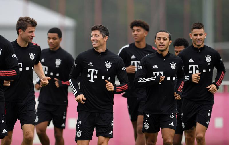Soccer Football - Bayern Munich Training - Saebener Strasse, Munich, Germany - September 11, 2020  Bayern Munich's Thomas Muller, Robert Lewandowski and Thiago with teammates during training  REUTERS/Andreas Gebert