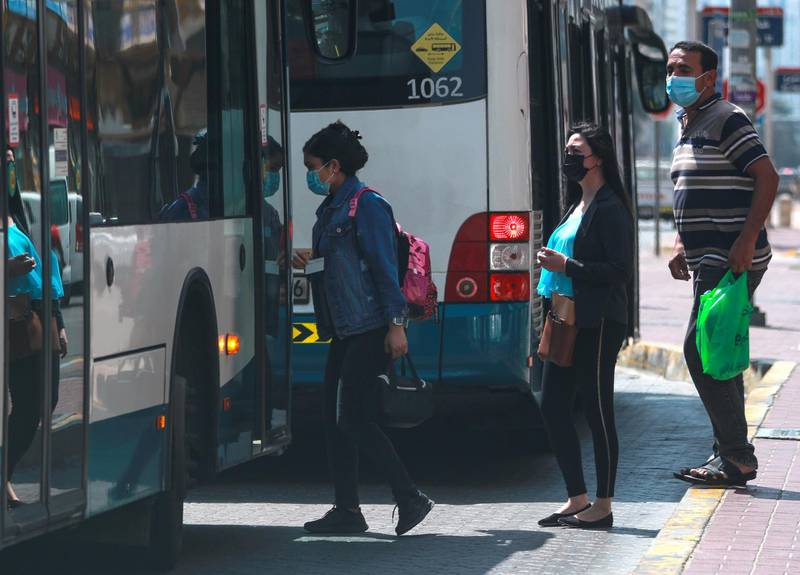 Abu Dhabi, United Arab Emirates, March 2, 2021.   Stock images covid. Commuters get on a bus at Hamdan St. central Abu Dhabi.Victor Besa / The NationalSection:  NA/Stock Images