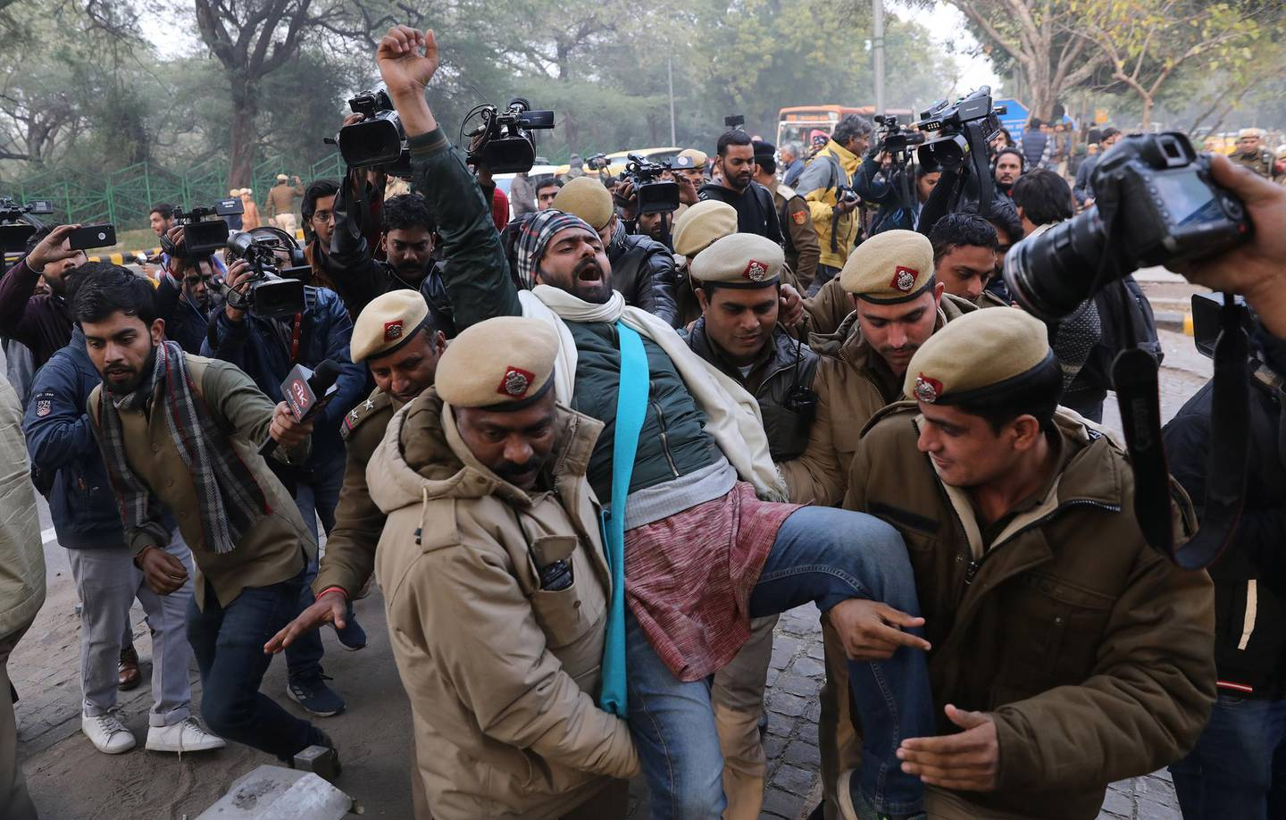 epa08091737 Indian Security personnel detain Indian student activists during a protest against alleged police brutality on protesters in Uttar Pradesh state, against the Citizenship Amendment Act (CAA) and the National Register of Citizens (NRC), outside the Uttar Pradesh Bhawan in New Delhi, India, 27 December 2019. The bill will give Indian citizenship rights to refugees from Hindu, Jain, Buddhist, Sikhs, Parsi or Christian communities coming from Afghanistan, Bangladesh and Pakistan.  EPA/RAJAT GUPTA